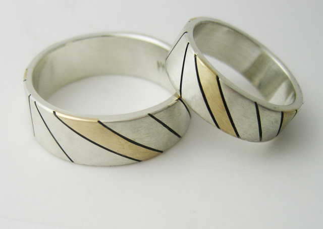 A Pair of Married Metals Wedding Bands Sterling and 18K